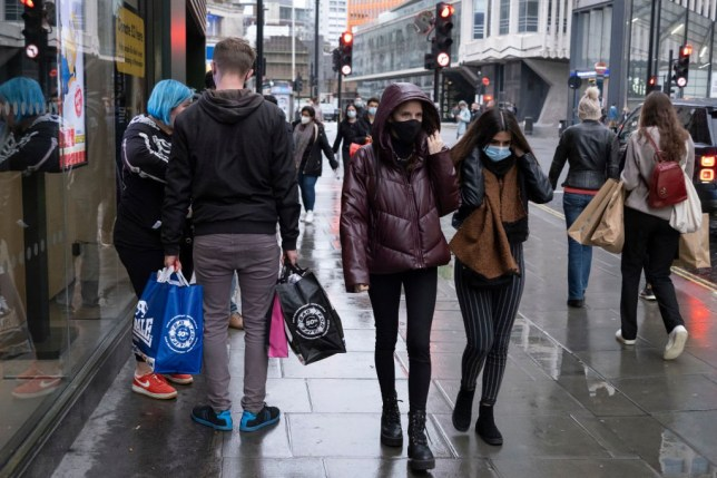 People in face masks in the West End of London