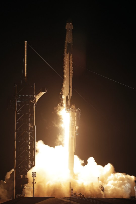 A Falcon 9 SpaceX rocket with the Crew Dragon capsule lifts off from pad 39A at the Kennedy Space Center in Cape Canaveral