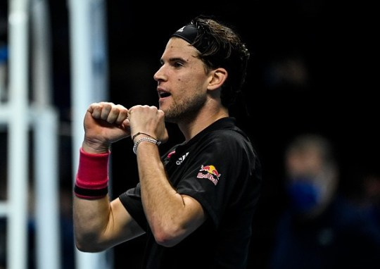 Dominic Thiem of Austria celebrates his victory over Novak Djokovic of Serbia on Day 7 of the Nitto ATP World Tour Finals at The O2 Arena on November 21, 2020 in London, England.