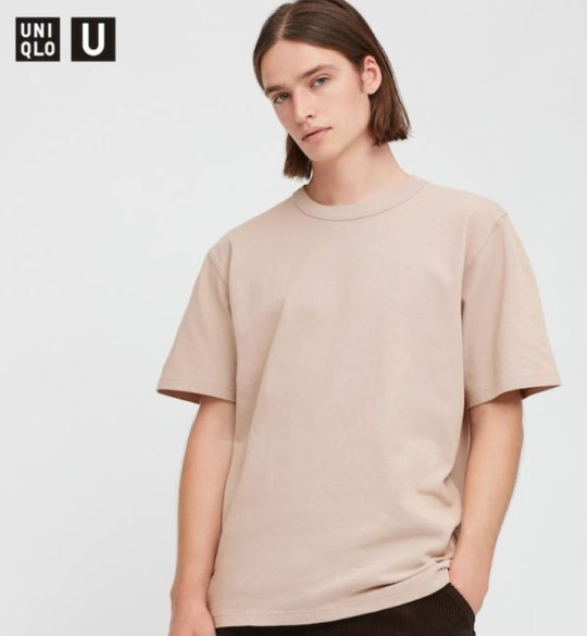 Model for UNIQLO's gender neutral fashion, wearing tonal t-shirt.