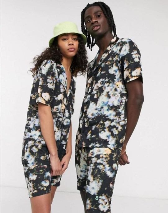 Man and woman modelling gender neutral fashion by ASOS, floral shorts and shirt.