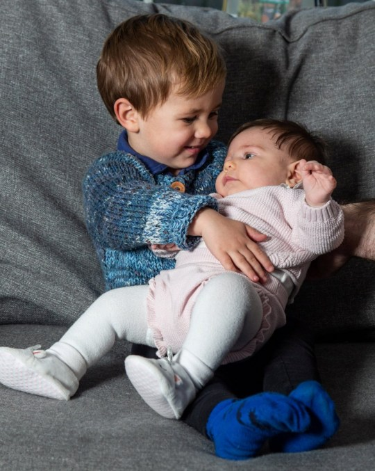 Cameron Marks, two, and his new-born sister Isabella, are considered twins after being conceived at the same time through IVF and from the same batch of embryos.
