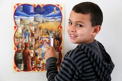 Young boy with an Advent calendar