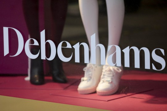 The Debenhams Plc logo in the window of their flagship department store on Oxford Street in central London, U.K., on Monday, Nov. 30, 2020. Philip Green's??Arcadia??Group is poised to seek protection from creditors and become the most notable U.K. retail insolvency since the beginning of the coronavirus pandemic. Photographer: Jason Alden/Bloomberg via Getty Images