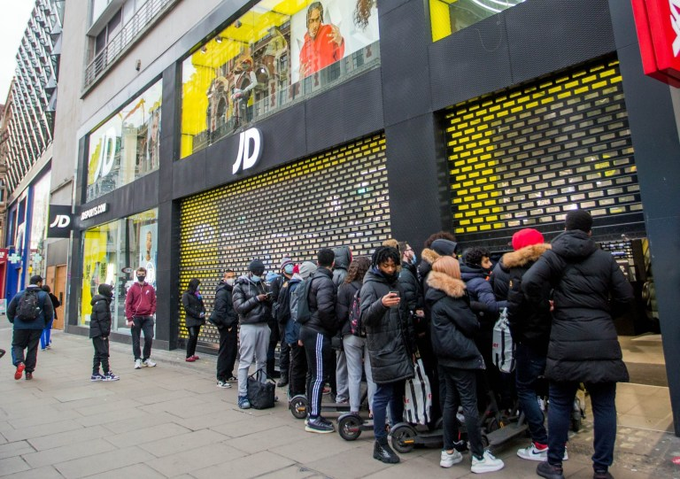 Image Licensed to i-Images Picture Agency. 02/12/2020. London, United Kingdom. Shops Reopen in London. Shoppers queue outside a branch of JD sports on Oxford Street as shops in London reopen following the end of the second Covid19 lockdown. Picture by Martyn Wheatley / i-Images