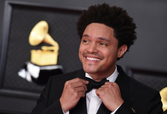 Trevor Noah arrives at the 63rd annual Grammy Awards at the Los Angeles Convention Center on Sunday, March 14, 2021. (Photo by Jordan Strauss/Invision/AP)