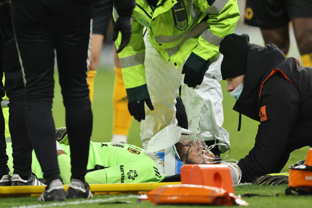 Rui Patricio of Wolverhampton Wanderers is placed on a stretcher during the Premier League match between Wolverhampton Wanderers and Liverpool at Molineux on March 15, 2021 in Wolverhampton, United Kingdom. Sporting stadiums around the UK remain under strict restrictions due to the Coronavirus Pandemic as Government social distancing laws prohibit fans inside venues resulting in games being played behind closed doors.