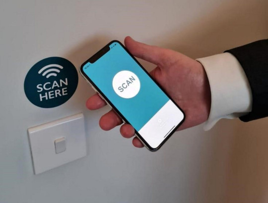 Countryside Homes free app - Scanning smartphone at scan point on the wall