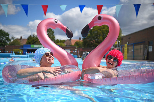 Swimmers Nicola Foster (left), 55, and Jessica Walker, 56, enjoying the water at Charlton Lido and Lifestyle Club in Hornfair Park, London