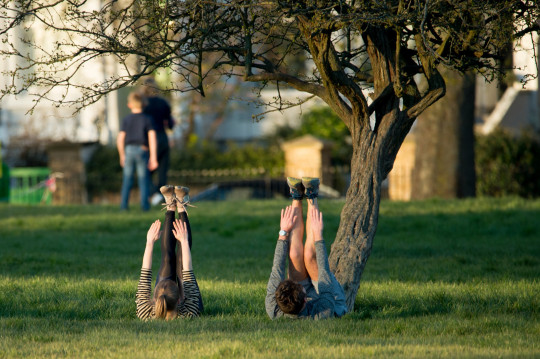 People are seen exercising in Primrose Hill on March 25, 2020 in London, United Kingdom