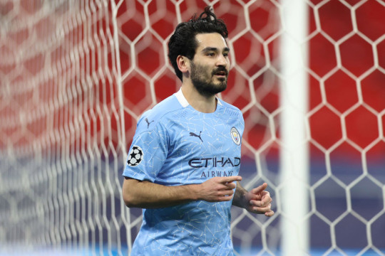 Ilkay Gundogan of Manchester City celebrates after scoring their side's second goal during the UEFA Champions League Round of 16 match between Manchester City and Borussia Moenchengladbach at Puskas Arena on March 16, 2021 in Budapest, Hungary. Manchester City face Borussia Moenchengladbach at a neutral venue in Budapest behind closed doors to prevent the spread of Covid-19 variants.
