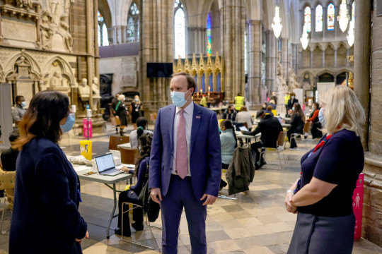 London, United Kingdom. Health Secretary Matt Hancock visits the Westminster Abbey Vaccination Centre and watches the MP for Windsor, Adam Afriyie, get vaccinated.