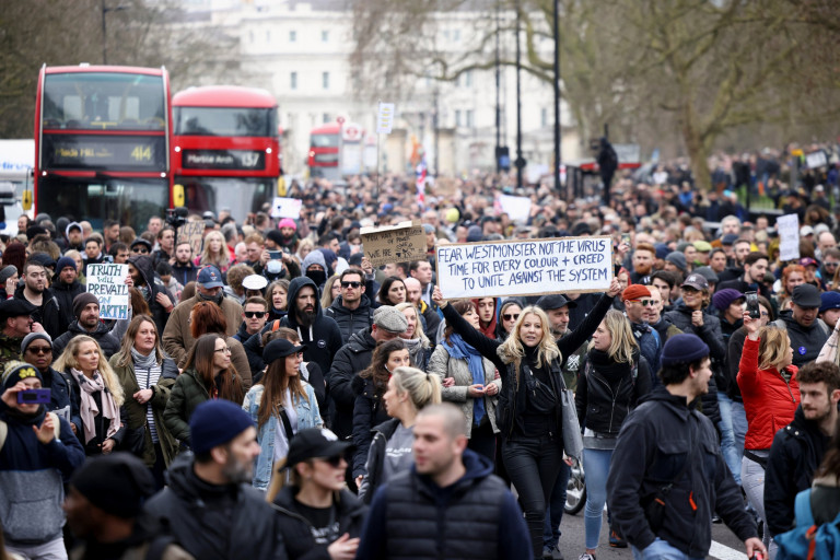 People participate in a protest against the lockdown, amid the spread of the coronavirus disease (COVID-19), on Oxford Street, in London, Britain March 20, 2021. REUTERS/Henry Nicholls