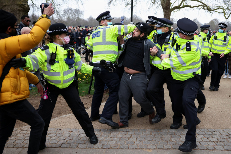 Police officers detain a demonstrator in Hyde Park during a protest against the lockdown, amid the spread of the coronavirus disease (COVID-19), in London, Britain March 20, 2021. REUTERS/Henry Nicholls