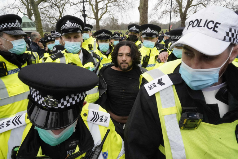 Police officers detain an anti-lockdown protester in central London on March 20, 2021 after demonstrators against the ongoing coronavirus restrictions gathered. (Photo by Niklas HALLE'N / AFP) (Photo by NIKLAS HALLE'N/AFP via Getty Images)