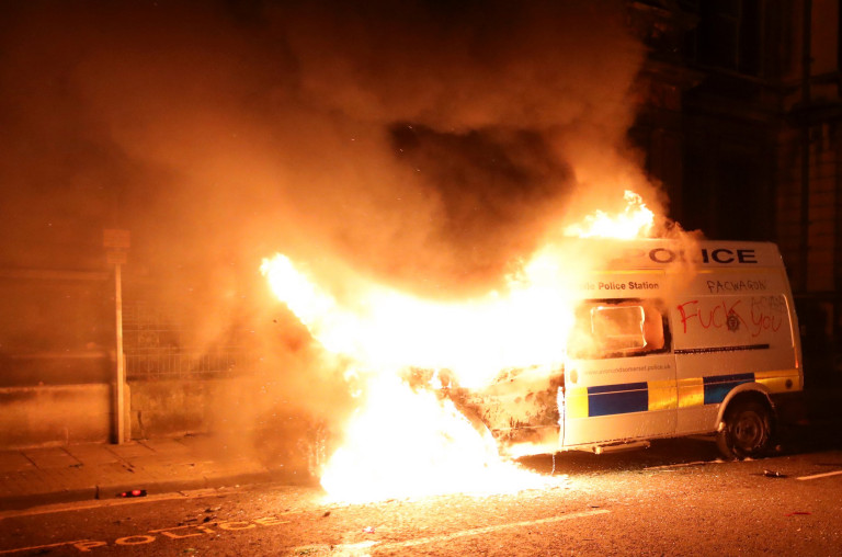 SENSITIVE MATERIAL. THIS IMAGE MAY OFFEND OR DISTURB A view shows a burning police vehicle during a protest against a new proposed policing bill, in Bristol, Britain, March 21, 2021. REUTERS/Peter Cziborra