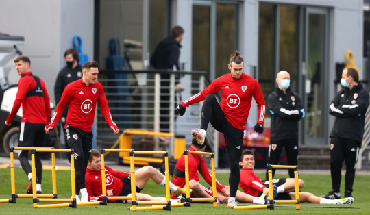 Connor Roberts and Gareth Bale of Wales warm up during a Wales Training Session at The Vale Resort on March 23, 2021 in Vale of Glamorgan, Wales.