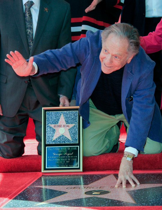 epa09092669 (FILE) - US actor George Segal poses with his star on the Hollywood Walk of Fame during the official ceremony in Hollywood, California, USA, 14 February 2017 (reissued 24 March 2021). Oscar-nominated actor George Segal died on 23 March 2021 due to complications from heart bypass surgery. He was 87. EPA/NINA PROMMER