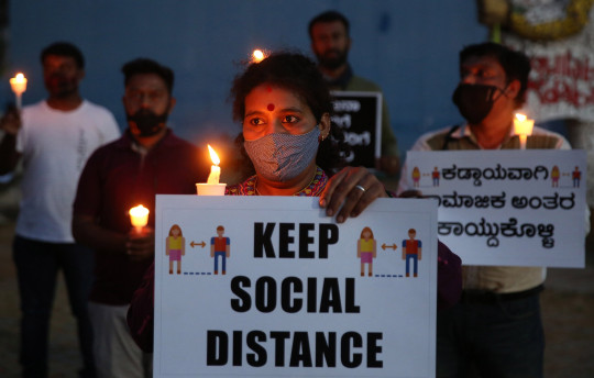 epa09093676 Members of Bangalore Citizen Forum holds placards during a candle vigil for the people who lost their life in coronavirus COVID19 pandemic in Bangalore, India, 24 March 2021. Karnataka state recorded 2,010 new infections, the highest single-day spike in 2021, while Bangalore recorded 886 cases. India has recorded 47,262 fresh COVID-19 cases its highest single-day spike reported across the country. EPA/JAGADEESH NV