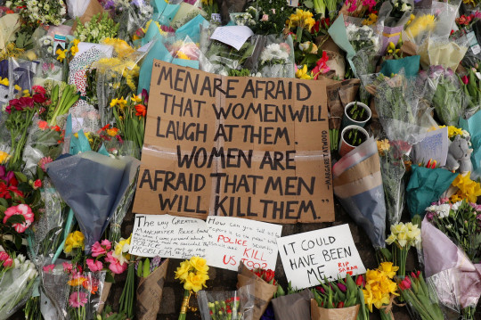 LONDON, ENGLAND - MARCH 15: Floral tributes and messages are placed in tribute to Sarah Everard at Clapham Common on March 15, 2021 in London, England. Hundreds of people turned out at Clapham Common on Saturday night to pay tribute to Sarah Everard, a 33-year-old London resident whose kidnapping and death - allegedly at the hands of an off-duty Metropolitan Police officer - prompted a wave of concern over women's safety. The same police force is being criticised for its response to the vigil, where they forcibly arrested several participants for violations of pandemic-era rules on public assembly. (Photo by Dan Kitwood/Getty Images)