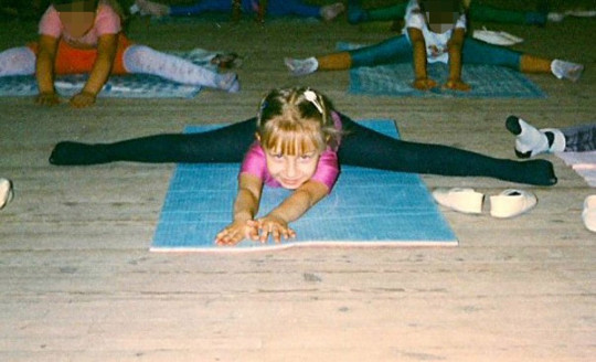 Five year old Anastasia doing the splits at dance class in 1998.
