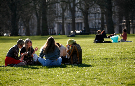 Mandatory Credit: Photo by David Cliff/NurPhoto/REX (11792871aj) People sit out in Green Park in mild spring weather in London, England, on March 9, 2021. Yesterday marked the first stage of coronavirus lockdown easing across England, with schools reopening and some limits on social contact loosened. Non-essential shops, bars, restaurants and other hospitality businesses remain closed, however, and will not reopen until next month under the current timetable. Daily Life In London Under Continuing Coronavirus Restrictions, United Kingdom - 09 Mar 2021