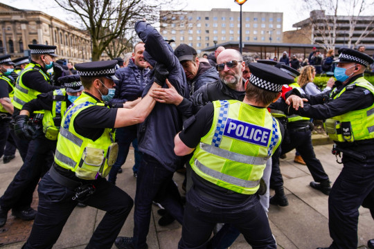 ?? Licensed to London News Pictures. 27/03/2021. Bradford, UK. Protesters clash with police officers during an anti-lockdown protest in Bradford.Photo credit: Ioannis Alexopoulos/LNP