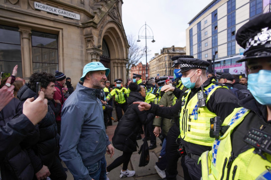 ?? Licensed to London News Pictures. 27/03/2021. Bradford, UK. Police officers clash with protesters during an anti-lockdown protest in Bradford.Photo credit: Ioannis Alexopoulos/LNP
