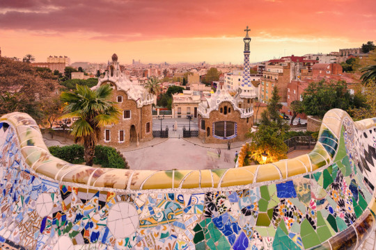 Parc Guell at sunset, view of the city with seaside in background. Barcelona, Spain
