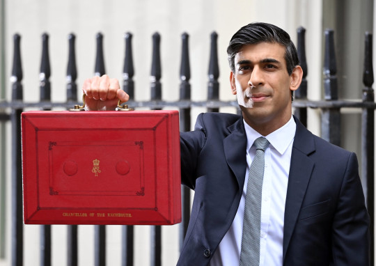 Chancellor Of The Exchequer, Rishi Sunak stands with the Budget Box outside 11 Downing Street. The Government spent £570,321 on chauffering red boxes and documents last year.