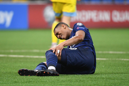 Anthony Martial of France looks injured during the Qualifying World Cup match between Kazakhstan and France