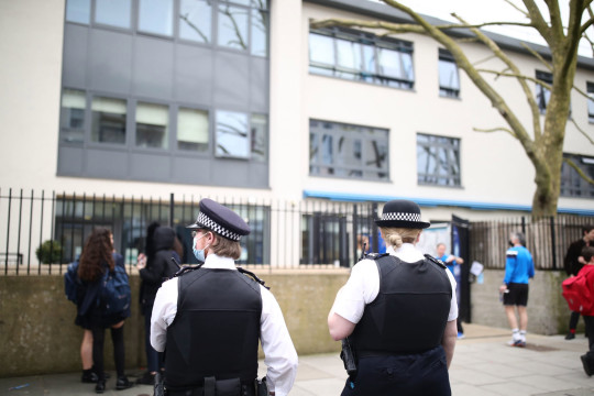 Police officers outside Pimlico Academy School, west London, where students have staged a walkout in protest over a school uniform policy that they claim is discriminatory and racist. Picture date: Wednesday March 31, 2021. PA Photo. Photo credit should read: Aaron Chown/PA Wire