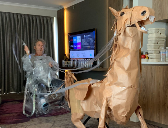 David Marriott on a fake clingfilm carriage connected to his paper horse. David Marriott has kept himself entertained  during his hotel quarantine at Rydges South Bank hotel in Brisbane, Australia.