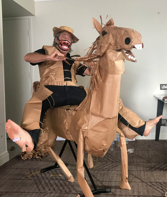 David Marriott poses with his paper horse. David Marriott has kept himself entertained  during his hotel quarantine at Rydges South Bank hotel in Brisbane, Australia.