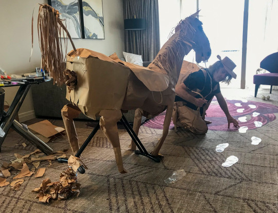 David Marriott leading his paper horse in his hotel room. David Marriott has kept himself entertained  during his hotel quarantine at Rydges South Bank hotel in Brisbane, Australia.