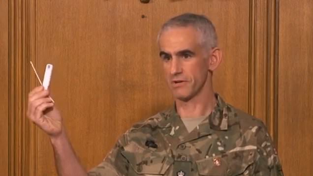 Military commander visually explains the 'lateral flow test'