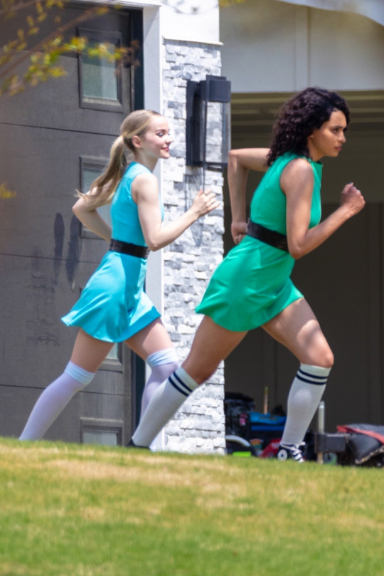 Atlanta, GA - *EXCLUSIVE* - The Powerpuff Girls Chloe Bennet, Dove Cameron, and Yana Perrault pictured filming Live-Action CW Pilot with actor Donald Faison and Robin Lively in Atlanta. The Scrubs doc Donald Faison will play Professor Drake Utonium! Based on the original Cartoon Network animated series, this new iteration picks up with the titular heroines as ???disillusioned twentysomethings who resent having lost their childhood to crime-fighting. Pictured: Dove Cameron, Yana Perrault BACKGRID USA 7 APRIL 2021 USA: +1 310 798 9111 / usasales@backgrid.com UK: +44 208 344 2007 / uksales@backgrid.com *UK Clients - Pictures Containing Children Please Pixelate Face Prior To Publication*