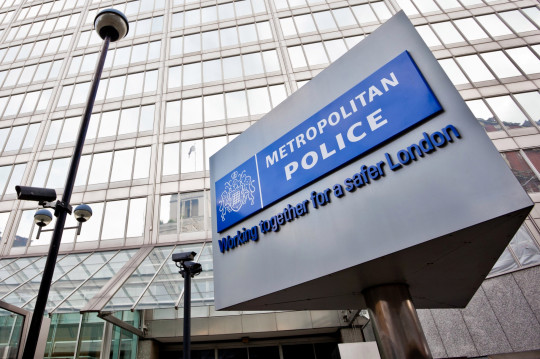 London, United Kingdom - September 3, 2011: The headquarter of the London Metropolitan police, New Scotland Yard and its revolving sign outside, which performs over 14,000 revolutions every day.