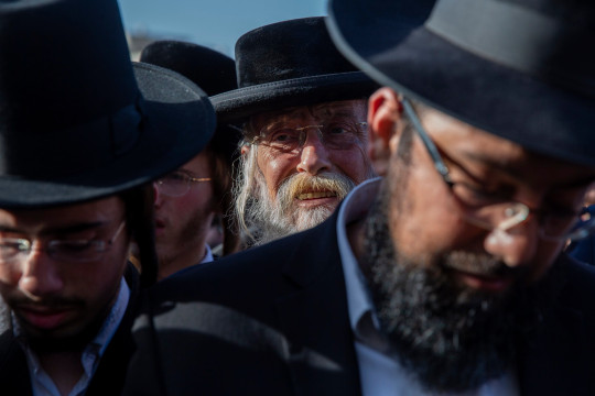 Mourners attend the funeral of a person who died during Lag BaOmer celebrations at Mt. Meron in northern Israel, in Jerusalem on Friday, April 30, 2021. A stampede at the religious festival attended by tens of thousands of ultra-Orthodox Jews in northern Israel killed dozens of people and injured about 150 early Friday, medical officials said. It was one of the country's deadliest civilian disasters. (AP Photo/Ariel Schalit)