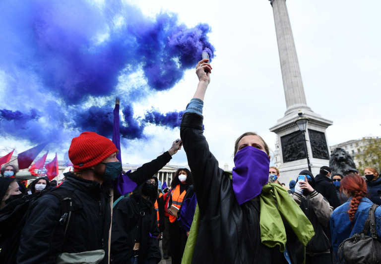 Mandatory Credit: Photo by James Veysey/REX (11884577o) People wave blue flares during the march at the Kill the Bill May Day protest in Trafalgar Square Kill the Bill May Day protest, London, UK - 01 May 2021