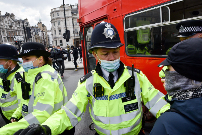 Mandatory Credit: Photo by Matthew Chattle/REX (11885006n) Kill the Bill protesters in Trafalgar Square. A double decker bus briefly enters the square. Kill the Bill protest, London, UK. - 1 May 2021