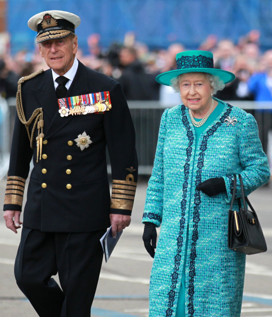 File photo dated 04/07/14 of Queen Elizabeth II and the Duke of Edinburgh at the formal naming ceremony for HMS Queen Elizabeth in Rosyth Dockyard, Fife. The Duke of Edinburgh was the longest-serving consort in British history. Philip overtook the record of 57 years and 70 days set by Queen Charlotte, wife of King George III, on April 18 2009. Issue date: Friday April 4, 2021. PA Photo. See PA story ROYAL Philip. Photo credit should read: Andrew Milligan/PA Wire