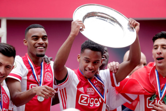 Ryan Gravenberch of Ajax, Jurrien Timber of Ajax celebrates the championship with the trophy during the Dutch Eredivisie  match between Ajax v FC Emmen at the Johan Cruijff Arena on May 2, 2021 in Amsterdam Netherlands