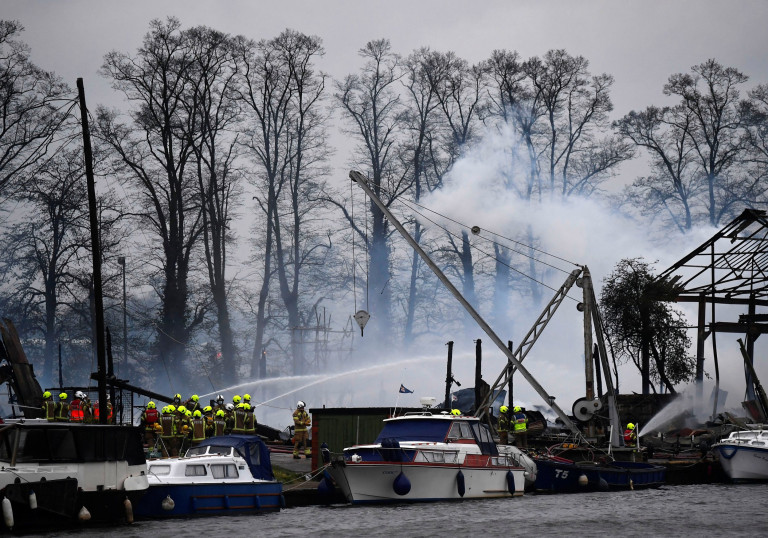 Firefighters tackle a blaze at a boatyard next to the River Thames, Hampton, west London, Britain, May 3, 2021. REUTERS/Toby Melville