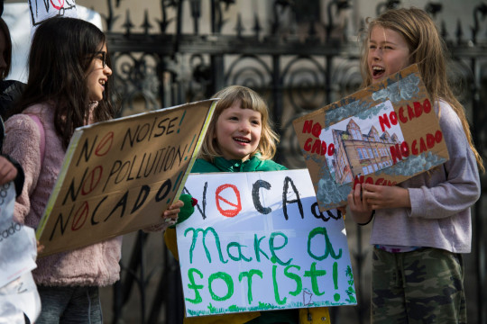 'No noise, no pollution, NOcado' reads one of the placards (Picture: PA)