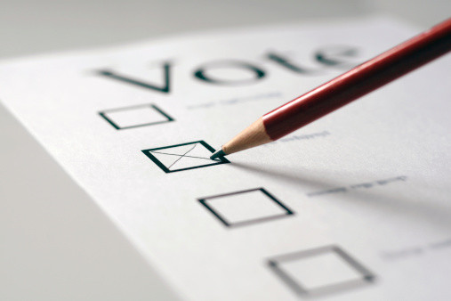 A pencil marking an X in a box on a voting ballot paper.