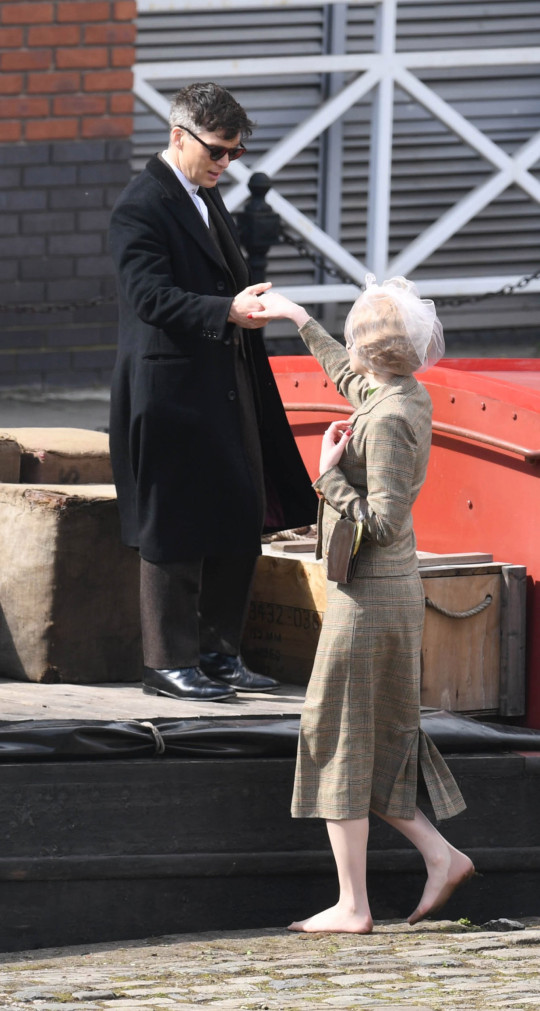 Pics Paul Cousans/Zenpix Ltd.. Peaky Blinders filming in Manchester sees CIlliam Murphy taken the hand of a young blonde Beaty as she joins him on a barge in the latest scenes to Be filmed for the new series todaY