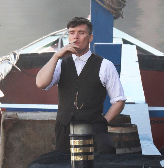 5.5.21....Peaky Blinders is back filming in Castlefield , Manchester after a covid induced break. Cilliam Murphy who play Tommy Shelby films on a boat on the canal basin on Wednesday afternoon.