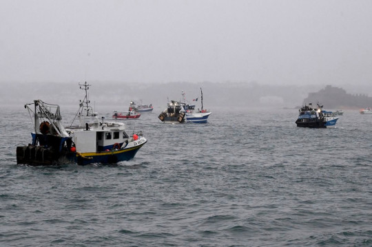 A flotilla of fishing vessels are seen in St Helier harbour, Jersey as French fishermen protest post Brexit changes to fishing in the area, May 6 2021 See SWNS story SWPLjersey. Jersey's government has called for an urgent de-escalation of tensions between the Island and France.