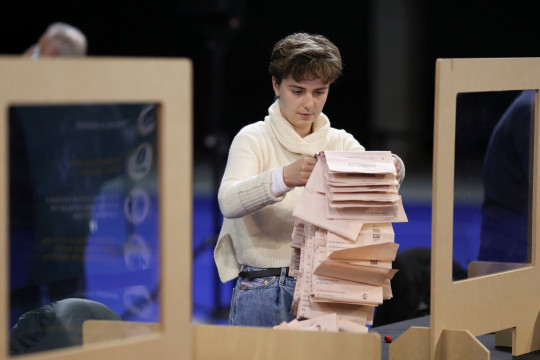 An election staff member counts votes for the Scottish Parliamentary election at a counting centre in Glasgow, Scotland, Britain, May 8, 2021. REUTERS/Russell Cheyne